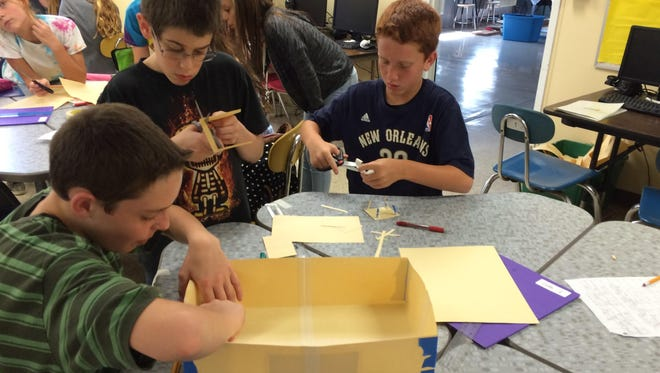 Students work on a scale model of their bee hive.