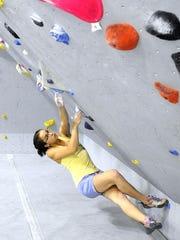 Emma Palmer climbs at Mesa Rim.