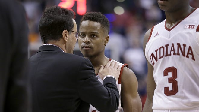 Tom Crean consoles Yogi Ferrell (11) following their loss to the Michigan Wolverines in their Big Ten tournament Friday.