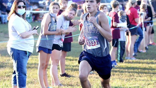 Greenwood's Noah Embrey finishes first in the Boys High School 5K, Thursday, Oct. 8, in the Greenwood XC Invitational in Bell Park. Noah is the 15-year-old son of Kim and John Embrey.