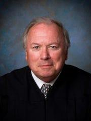 State Supreme Court Justice James Tormey.