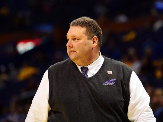 Evansville Aces head coach Marty Simmons looks on as his team plays the Indiana State Sycamores during the first half of the Missouri Valley Conference tournament at Scottrade Center.