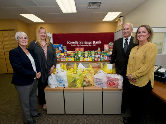 Roselle: Roselle Savings Bank brightens the lives of local families with Thanksgiving food donations PHOTO CAPTION