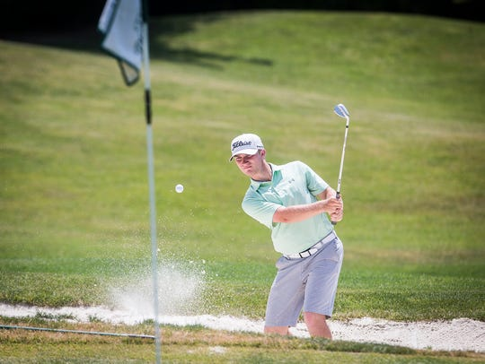New Castle's Brady Wheeler competes in the golf regional