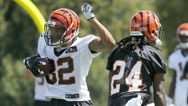 Marvin Jones, left, has been easing himself back into practice as he makes sure his legs are ready for the season.