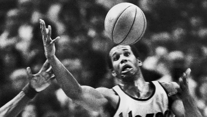 In this Dec. 25, 1979, file photo, Portland Trail Blazers'  Kermit Washington gains control of a loose ball during an NBA basketball game against the Golden State Warriors in Portland.