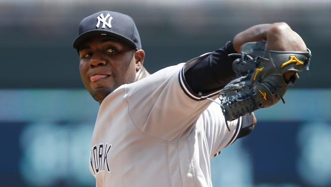 New York Yankees pitcher Michael Pineda throws against the Minnesota Twins in the first inning of a baseball game Saturday, June 18, 2016, in Minneapolis.