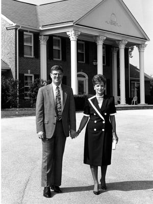 In a photo taken in the early 1990s, Brona Maddox and Carson-Newman President Dr. Cordell Maddox stand in front of what was then The President's Home on Laurel Hills Circle in Jefferson City.
