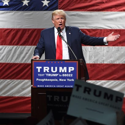 Donald Trump speaks during his rally at the Mid-Hudson Civic Center on Sunday.
