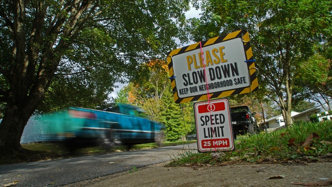 A truck on Wednesday drives on Owen Drive in Kirkwood Gardens, where resident Jeanna McGinnis this summer put a sign meant to address speeders. The street is a shortcut between Kirkwood Highway and Milltown Road.