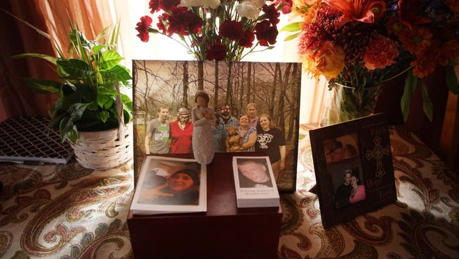 A memorial with the ashes of 25 year-old Brandon Jones, sit in the family room of his mother Tammy Jone's home in Millington, Md. A  picture of his girlfriend 25 year-old Chelsea M. Porter sits next to his.