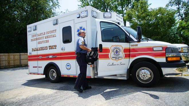 New Castle County paramedic Sr. Cpl. Chris Reed unloads an emergency vehicle in the parking lot of Middletown station that has no secure covered area for their vehicles.