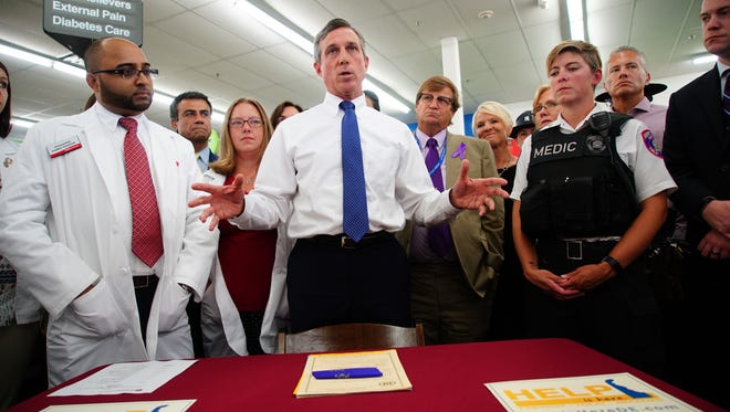 Gov. John Carney speaks in front of a pharmacist, lawmakers and members of the community affected by opioid addiction, before he signed Senate Bill 48, which increases pharmacy access to naloxone, an antidote for those suffering from opioid overdoses.