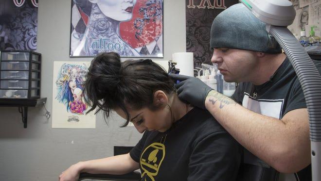 """Arizona Republic staffer Melissa Farley gets a """"Star Wars"""" tattoo in metro Phoenix."""