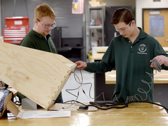 Drake Abel, right, and David Sheeler, juniors at York County School of Technology, work on Abel's homemade pinball machine in engineering class on Friday, Feb. 10, 2017.