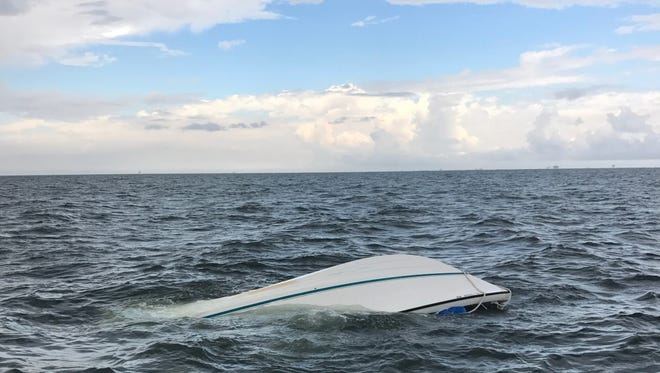 The Coast Guard rescues four people from a boat that was taking on water approximately 18 miles southwest of Dauphin Island, Alabama, Aug. 5, 2017. The four people were transported to Station Dauphin Island in stable condition.