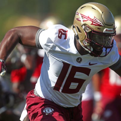 FSU's Tre' McKitty works out during their opening practice