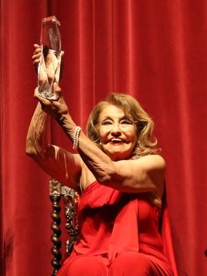 Actress Elsa Cárdenas receives the Plaza Classic Film Festival's Lifetime Achievement Award at the screening of the movie 'Giant' on Saturday in Downtown El Paso.