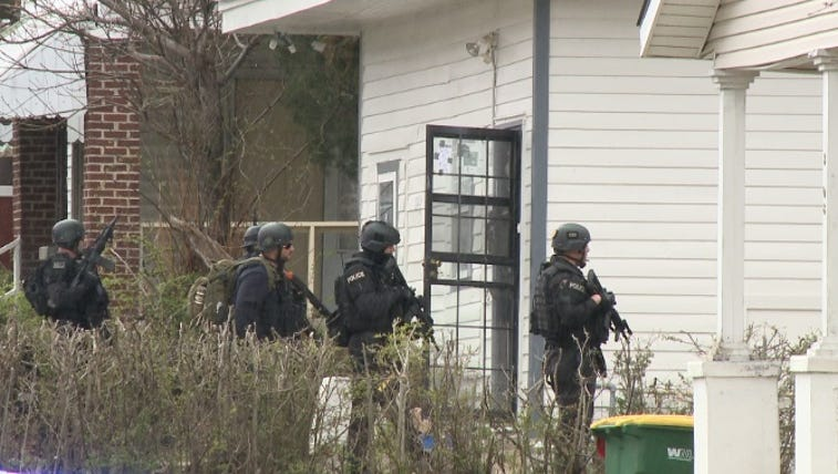 SWAT responding to home on W. 12th St. 3/27