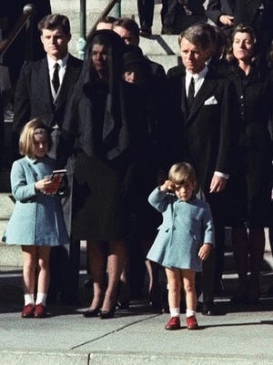 A 3-year-old John F. Kennedy Jr. salutes his father's casket in Washington in 1963, three days after the president was assassinated in Dallas.