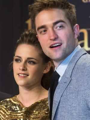 """Actors Kristen Stewart and Robert Pattinson attend the German premiere of """"The Twilight Saga: Breaking Dawn Part II"""" in Berlin, Friday, Nov. 16, 2012. (AP Photo/Markus Schreiber) ORG XMIT: OTK"""
