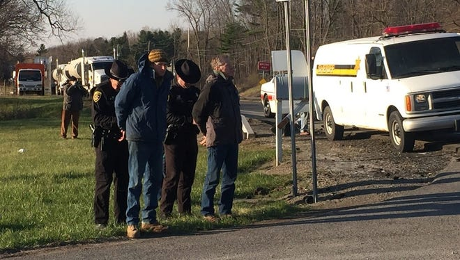 People are handcuffed by Schuyler County Sheriff's Office following a protest outside of Crestwood Midstream in the Town of Reading, Schuyler County, Thursday morning.