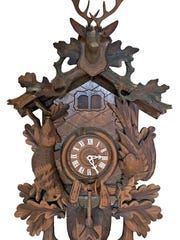 This West German hand-carved wooden Cuckoo Clock recently sold for $192 at auction.