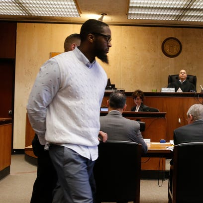 Basim Henry being led into court as the jury continues