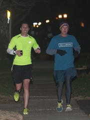 Haddon Hashers runners,  Scott Boyd, left, and Tim Groeling run as they get close to the P.J. Whelihan's Pub and Restaurant in Haddonfield. The Haddon Hashers get together once a month to run, drink, and run some more.