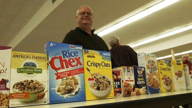 Don Gruenke volunteers at the St Peter Claver Catholic Church food pantry in Sheboygan. The pantry provides food to between 120 and 150 families a month.