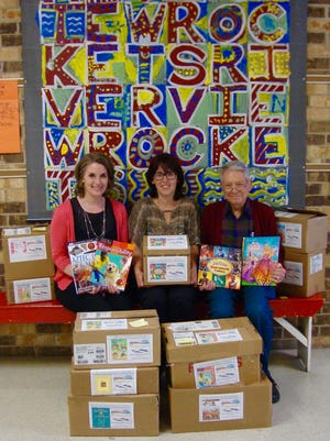Pictured, from left, is MPSD's ELL Coordinator and Riverview ELL teacher Renee Siikarla and First Presbyterian Church Children's Book Drive Team Lauryn Hibbard and Pete Stuntz.