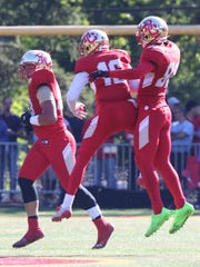 Cade McDermott and Aeneas DiCosmo celebrate a fumble recovered by Bergen Catholic during a 2016 game.