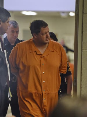 Todd Christopher Kohlhepp enters the courtroom for a bond hearing March 26, 2017, in Spartanburg, S.C. As officials continue to search for bodies on the property of the South Carolina, public records and court reports offer insight into the life of an accused killer who once lived in Arizona.