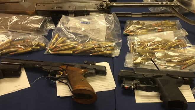 Weapons and ammunition seized by police in the arrest of Ramadan Abdullah.