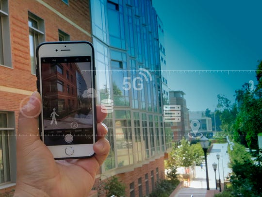 Artist's concept of smart phone using augmented reality