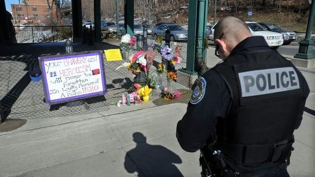 Soon after he was killed, an impromptu memorial for Detective John Falcone went up near the Poughkeepsie Train Station. A City of Poughkeepsie police officer stopped to pay respects.
