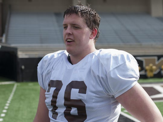 Harper Creek graduate Josh Bass has ended his college football playing career at Western Michigan because of health concerns. Bass remains on scholarship and will be a student coach in 2015.