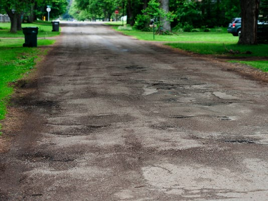-BCEBrd_06-22-2014_BCE_1_A002~~2014~06~21~IMG_potholes_02.jpg_1_1_QO7NCATG_L.jpg