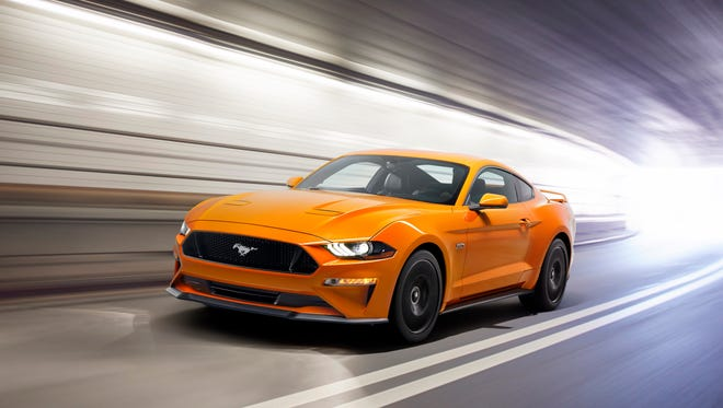 The updated 2018 Ford Mustang gets a lower hood, new lights, plus a quick shifting 10-speed automatic transmission and more power.