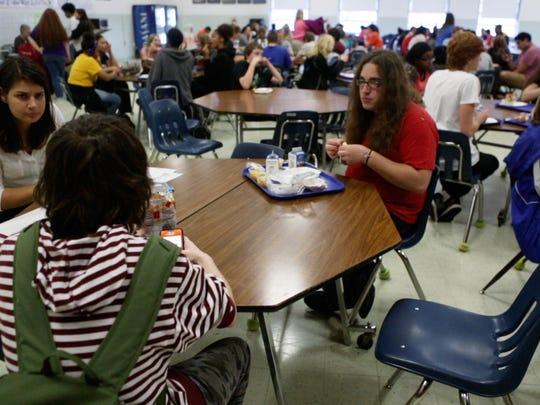 Kyle LeGore, right, has lunch with friends at Robert E. Lee High School on Nov. 6, 2015.