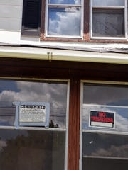 Signs on a home at 229 Lathrop Avenue indicate the property is condemned. The Post Addition was hit worse than any other Battle Creek neighborhood during the housing crisis.