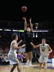 Norwalk senior Luke Vaske launches a jump shot. Norwalk