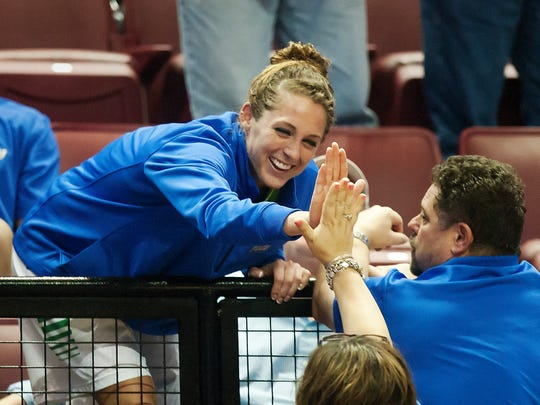 FGCU's Jenna Cobb is congratulated by a fan after FGCU