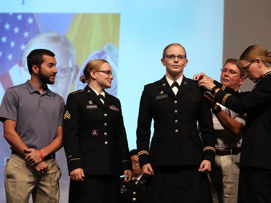 Second Lt. Stephanie Shutak (center) is pinned by her fiance, Seth Schoenert (from left), sister, Sgt. Caitlin Thompson, dad, Ret. Petty Officer 3rd Class David Shutak and mom, Ret. Col. Catherine Shutak during the Texas A&M University-Corpus Christi Islander Army ROTC Commissioning Ceremony on Friday, Aug. 4, 2017. The ceremony marks the transition of graduating ROTC students from cadets to enlisted officers. Each of the five students will be commissioned a second lieutenant in the Army.