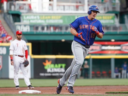 New York Mets' Jay Bruce runs the bases after hitting a two-run home run off Cincinnati Reds starting pitcher Homer Bailey in the third inning of a baseball game, Monday, May 7, 2018, in Cincinnati.