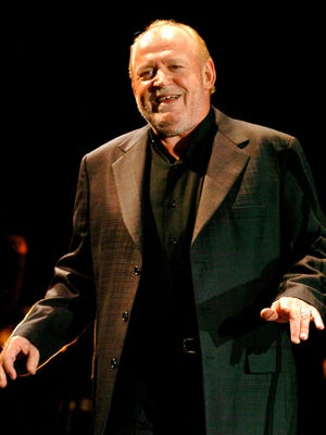 British rock singer Joe Cocker performs during his concert in Foenix Hall in Debrecen, Hungary, Nov. 7, 2007.