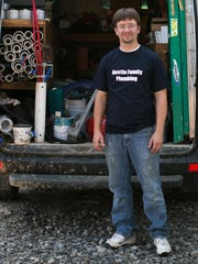 Shawn Austin, owner of Austin Family Plumbing in Spencerport, standing with some of the tools of his trade.