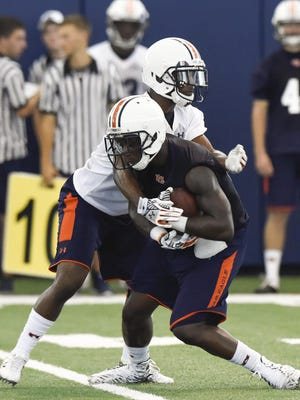 Blake Countess (24) wraps up Melvin Ray (82) during Auburn's fall practice Wednesday in Auburn.
