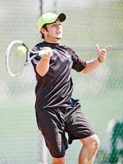 South Western's Quinn Meyer plays a return to John Schmitt on Saturday. Meyer will face teammate and No. 1 seed Anthony Miserendino at 4 p.m. today in the YAIAA Class AAA tennis final at South Western. (For The Evening Sun -- Jeff Lautenberger)