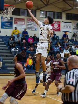 Carencro's Braylon Chaisson glides through the air for a basket during the Bears' win over Breaux Bridge on Tuesday. Chaisson finished with a team-high 19 points.